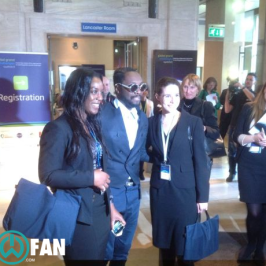 will.i.am presents award at Global Grand Challenge Summit