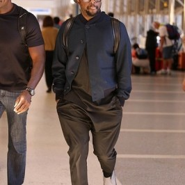 will.i.am seen at LAX